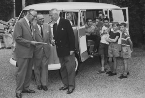 The local VW dealership hands over the  Microbus to one of the founders and a group of wide-eyed Pestalozzi children.