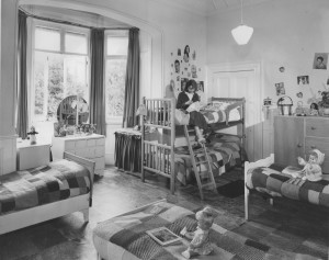 The first girls' bedroom in the Manor House.  Note the crocheted bed covers, donated by supporters.