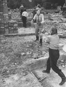 Stacking bricks from demolished buildings before the construction of the Cedarwood House.