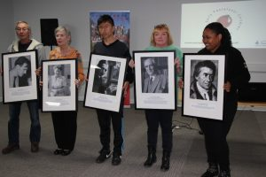 Presenting the images to be installed in the Founders' Display in the Pestalozzi Centre are (from left): Yogi, Sonja, Sonam Phuntsho (Bhutan), Irmina and Shaylynne Mckop (Zimbabwe)